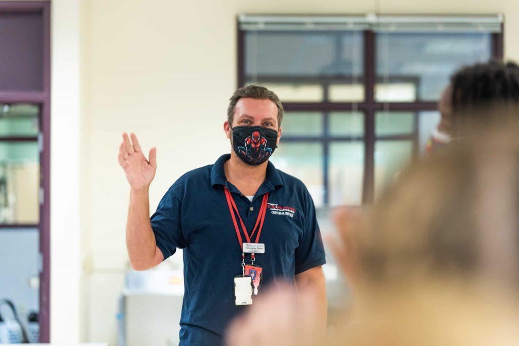 Chris Ulmer waving to students